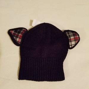 A black stocking hat with plaid ears